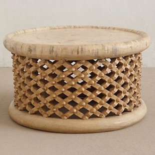 Anthropologie lattice drum coffee table copycatchic for Tribal carved coffee table