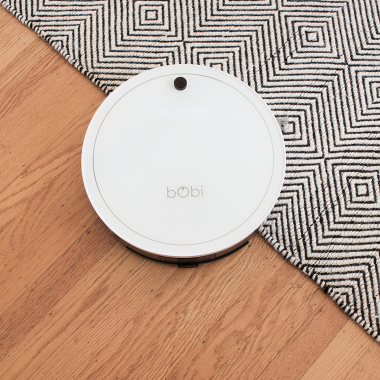 Reviewing the BobSweep bObi Classic Robotic Vacuum: It sweeps, vacuums, sterilizes, has a HEPA filter and MOPS all at the same time. @copycatchic cleaning