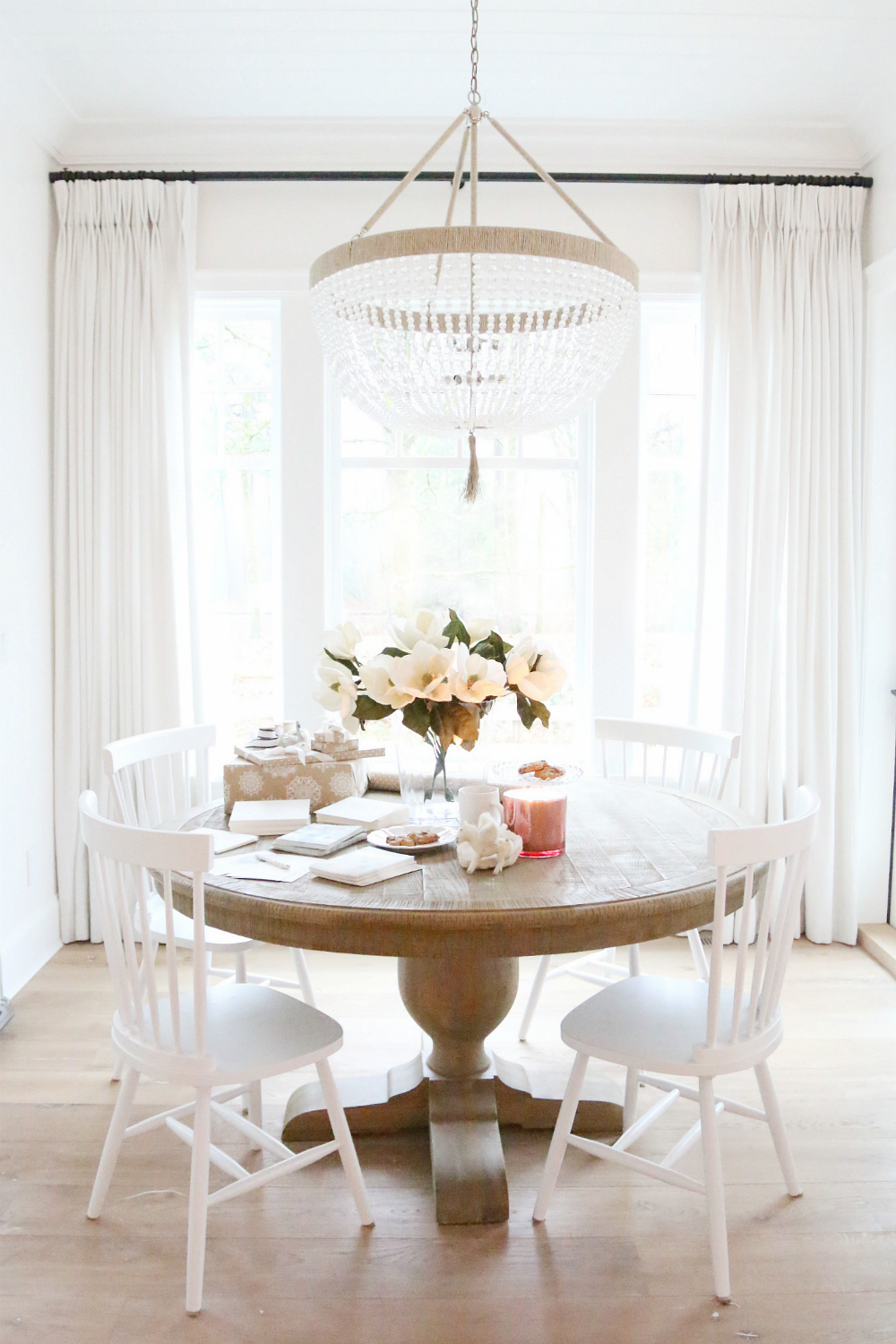 Restoration hardware french urn pedestal round dining table copy cat chic - Dining room table chandeliers ...