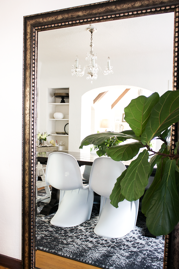 my copycatchic home tour: The dinging room update. A transitional dining room in black, white and gray with a vintage looking rug and modern chairs.