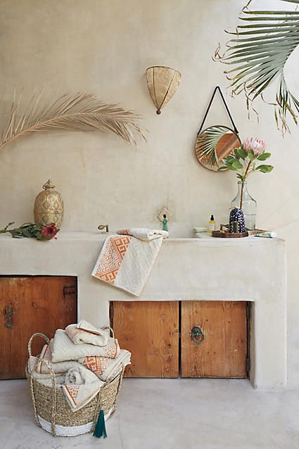 Anthropoogie Balinese Tassel Basket for $78 vs Large Seagrass Raffia Basket for $18 copycatchic luxe living for less budget home decor & design lookforless