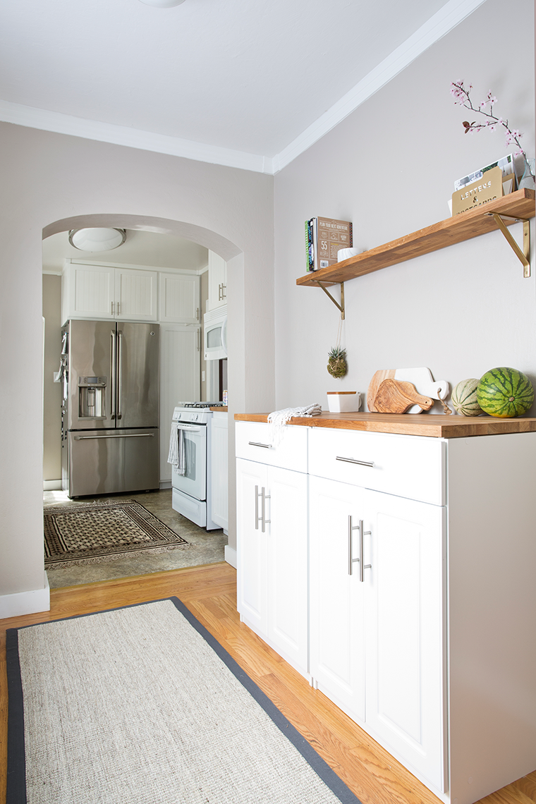 Decluttering and organizing the mudroom and kitchen prep area with cabinets from @orchardsupply minimalist home organization luxe living for less