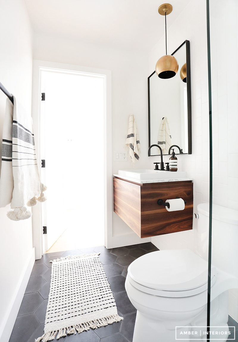 A black and white minimalist wood bathroom by Amber Interiors ...