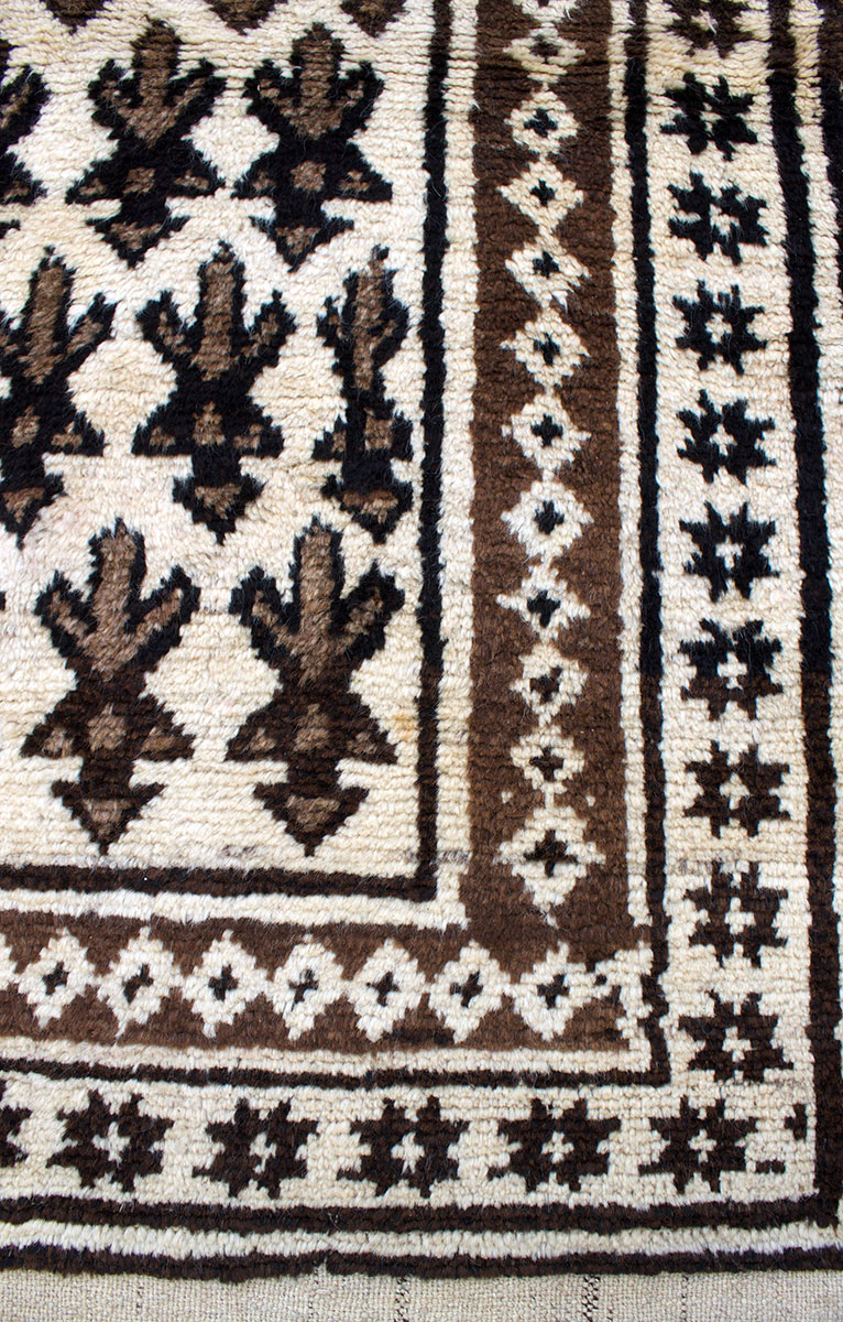 Copycatchic Arnow Rug vintage afghan undyed wool rug in ivory, brown and black.