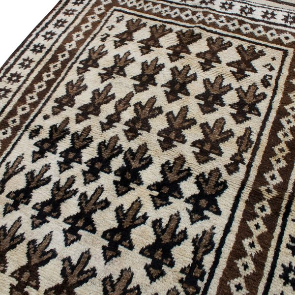 Copycatchic Arnow Rug vintage afghan undyed wool rug in ivory, brown and black.