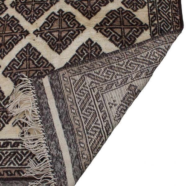 Copycatchic Baldwin Rug vintage afghan undyed wool rug in ivory, brown and black.