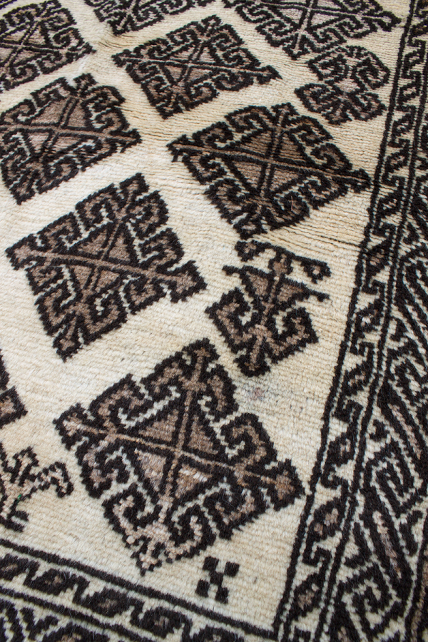 Copycatchic Baldwin Rug vintage afghan undyed wool rug in ivory, brown and black.