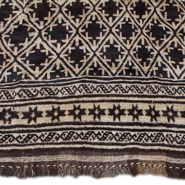 Copycatchic Daniels Rug vintage afghan tribal woven undyed wool rug in ivory, brown and black.