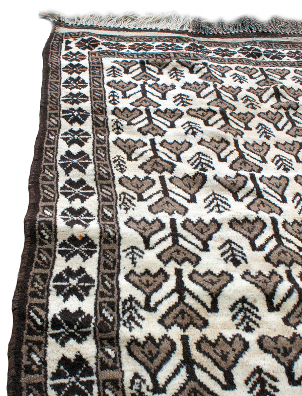 Copycatchic Emerson Rug vintage afghan tribal woven undyed wool rug in ivory, brown and black.