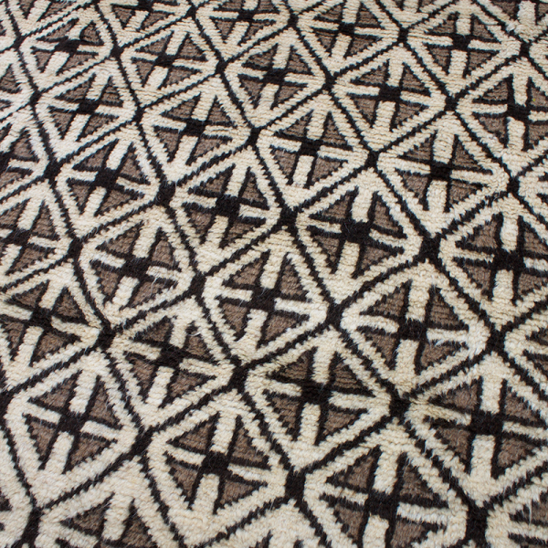 Copycatchic Fortuna Rug vintage afghan tribal woven undyed wool rug in ivory, brown and black.