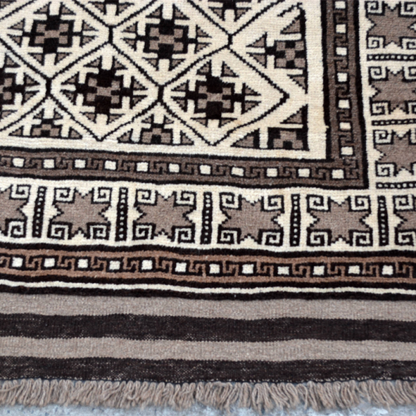 Copycatchic Gable Rug vintage afghan undyed wool rug in ivory, brown and black.