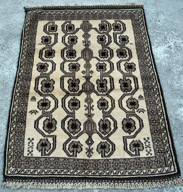 Copycatchic Irving Rug vintage afghan undyed wool rug in ivory, brown and black.