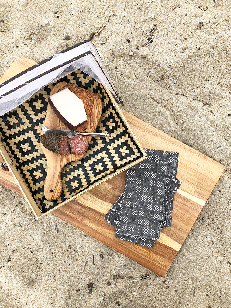 A minimalist, boho beach picnic for Mother's Day with World Market and copycatchic. Bohemian and ecclectic with ethnic accents combined with neutral textures like macramé and mudcloth prints. copycatchic luxe living for less budget home decor and design daily finds and room redos