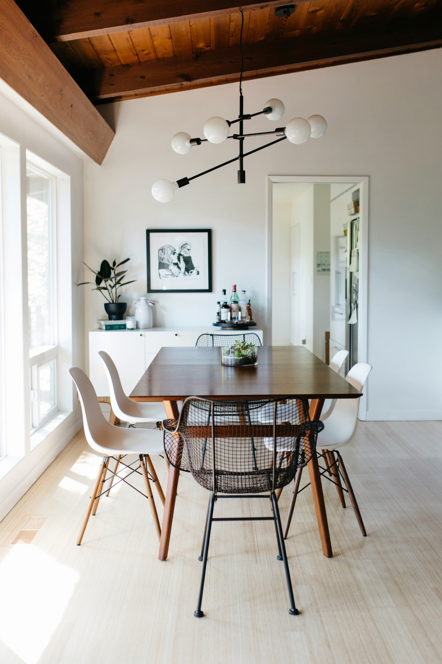 This minimalist mid century dining room featured by - How to decorate mid century modern on a budget ...