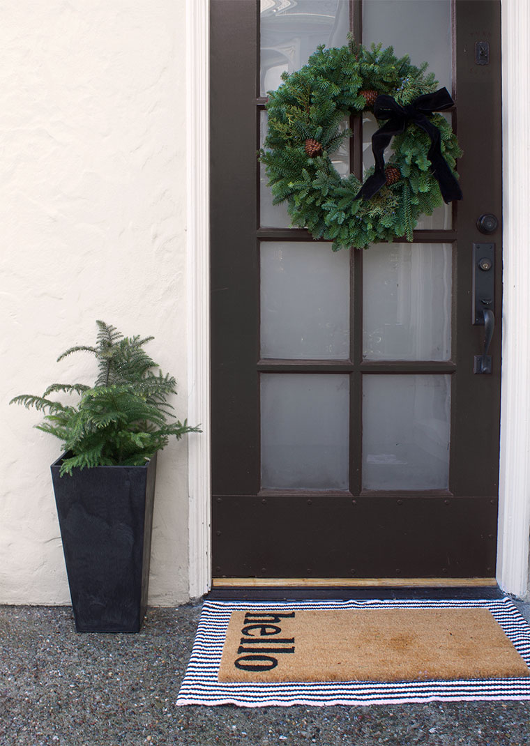 Time to update our entryway stoop for the holidays! I partnered with Walmart and outfitted it for less than $500 including a new light and bistro chairs! Walmart has so many great home furnishings, decor and holiday items which helped make my job even eaiser! Take a look! #walmart #ad #christmasentryway